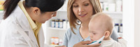 Pharmacist working with mother and child